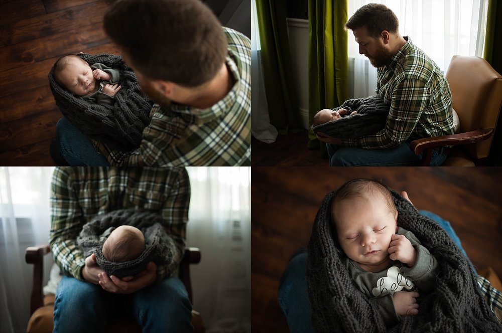 Pekin father holds his newborn during an in-home lifestyle session photographed by Brittney Hogue.