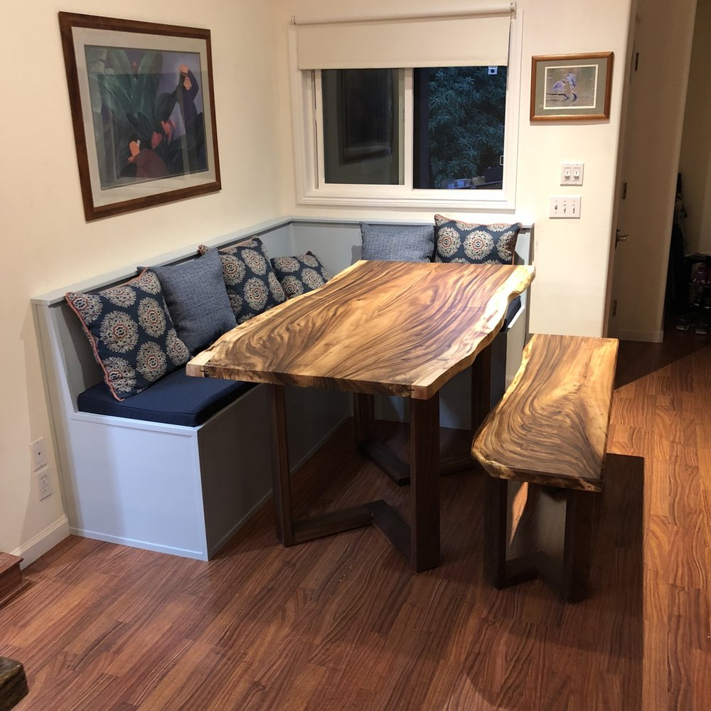 Matching dining table and bench set. The tabletop and benchtop are created from the same log, and the walnut base design is carried over from the dining table to the bench. They fit together perfectly!