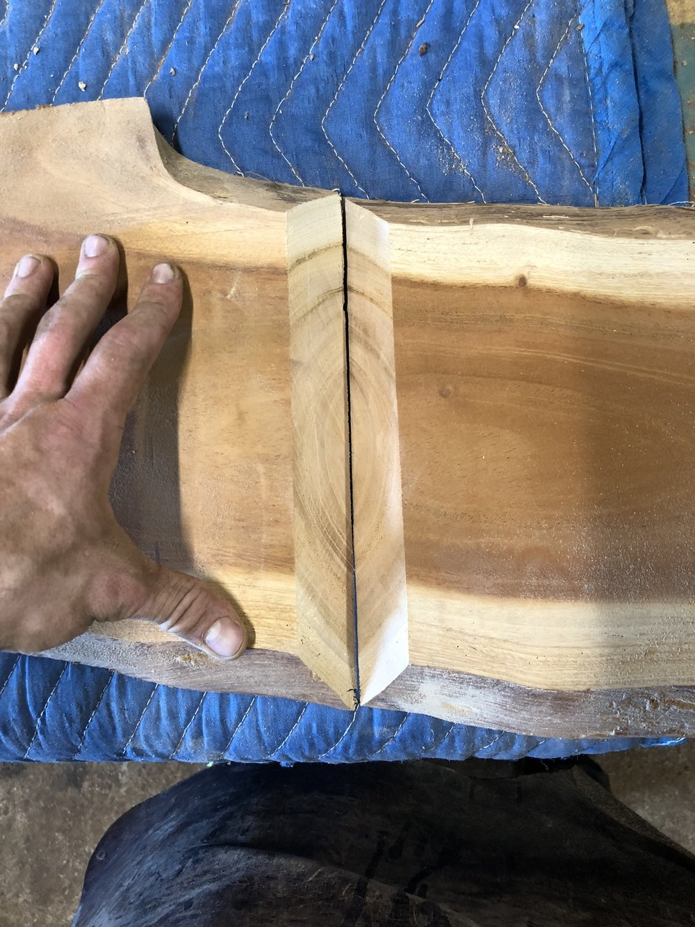"""The goal in this step is to cut both the top edge and the leg at 45*, which when combined will essentially """"fold"""" the slab to create the leg. Ideally, the grain waterfalls down the leg from the top, which is why this style is typically called a waterfall leg."""