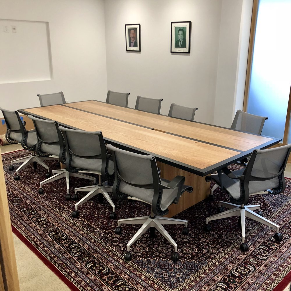 "Oak conference table. 10'x50"", with plenty seating for ten people."