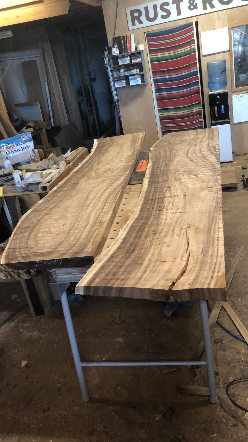 Two halves of the table sitting on my workbench. Although they're not that large, these slabs are still heavy to flip and move around. Back still vaguely sore.