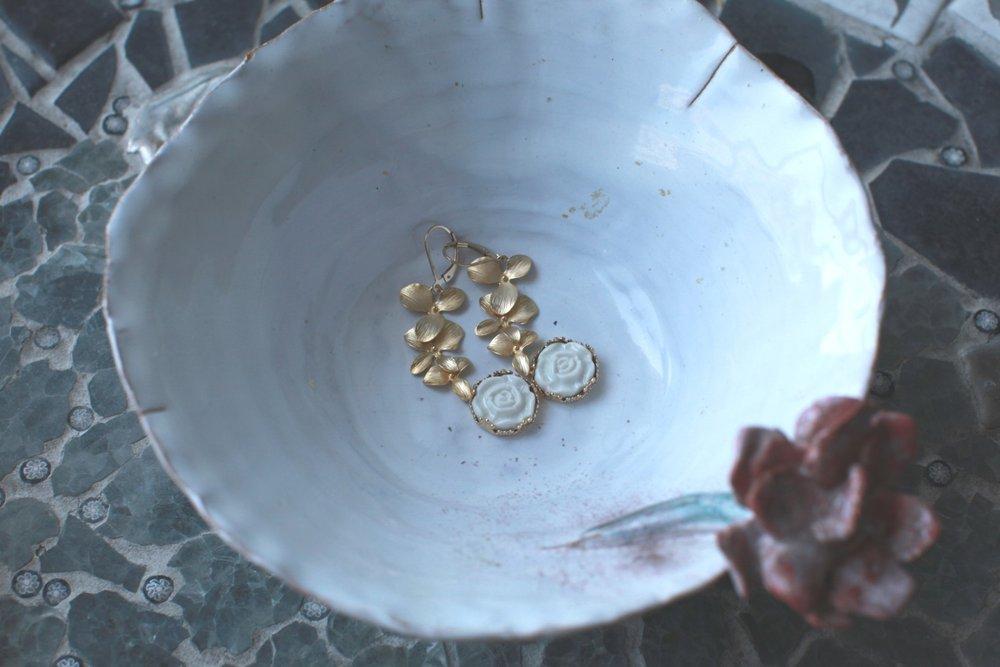 porcelain rose earrings from an emerging danish designer in a handmade ceramics bowl
