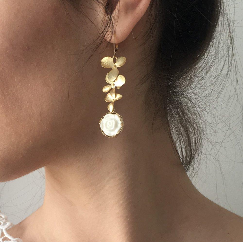 beautiful handmade golden rose porcelain earrings from an emerging Danish designer