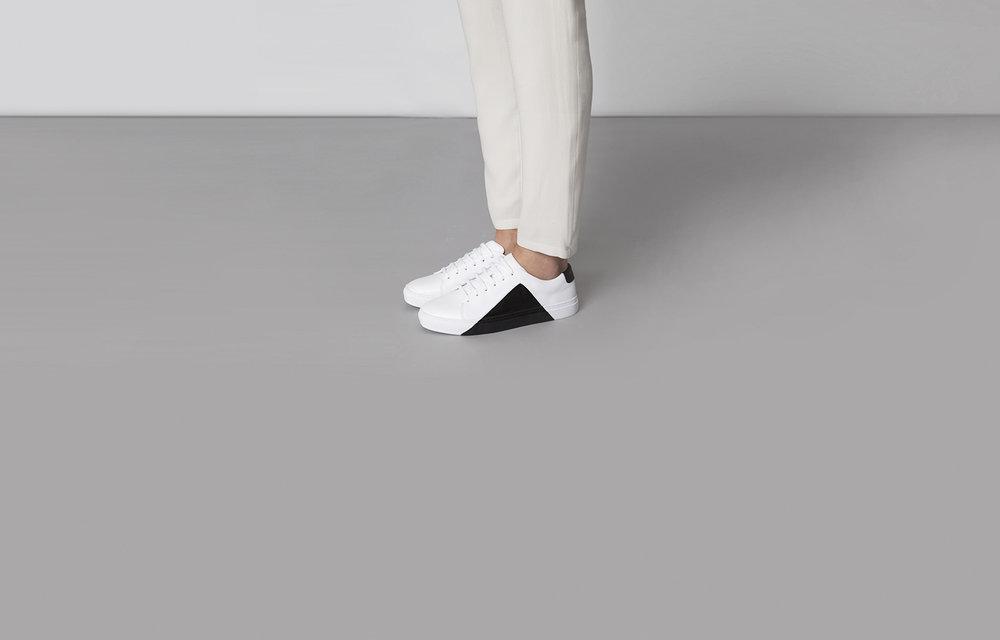 black triangle minimalistic design sneakers