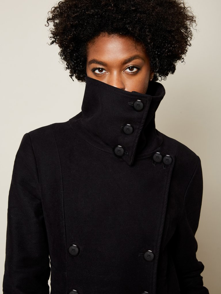 black vegan coat emerging brand