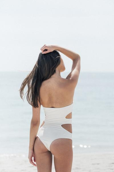 white strapless one piece with cutouts sustainable product