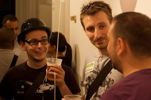 Chatting at a party. Image courtesy of Flickr user Iain Farrell