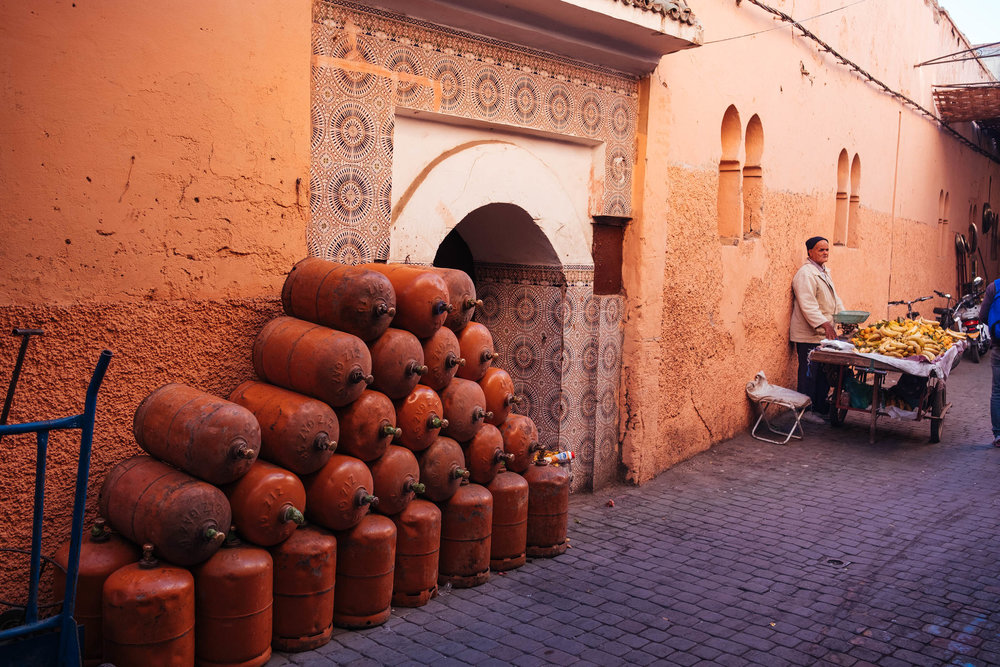 MARRAKECH, MOROCCO - NOVEMBER, 2017: Gas tanks and man on the st