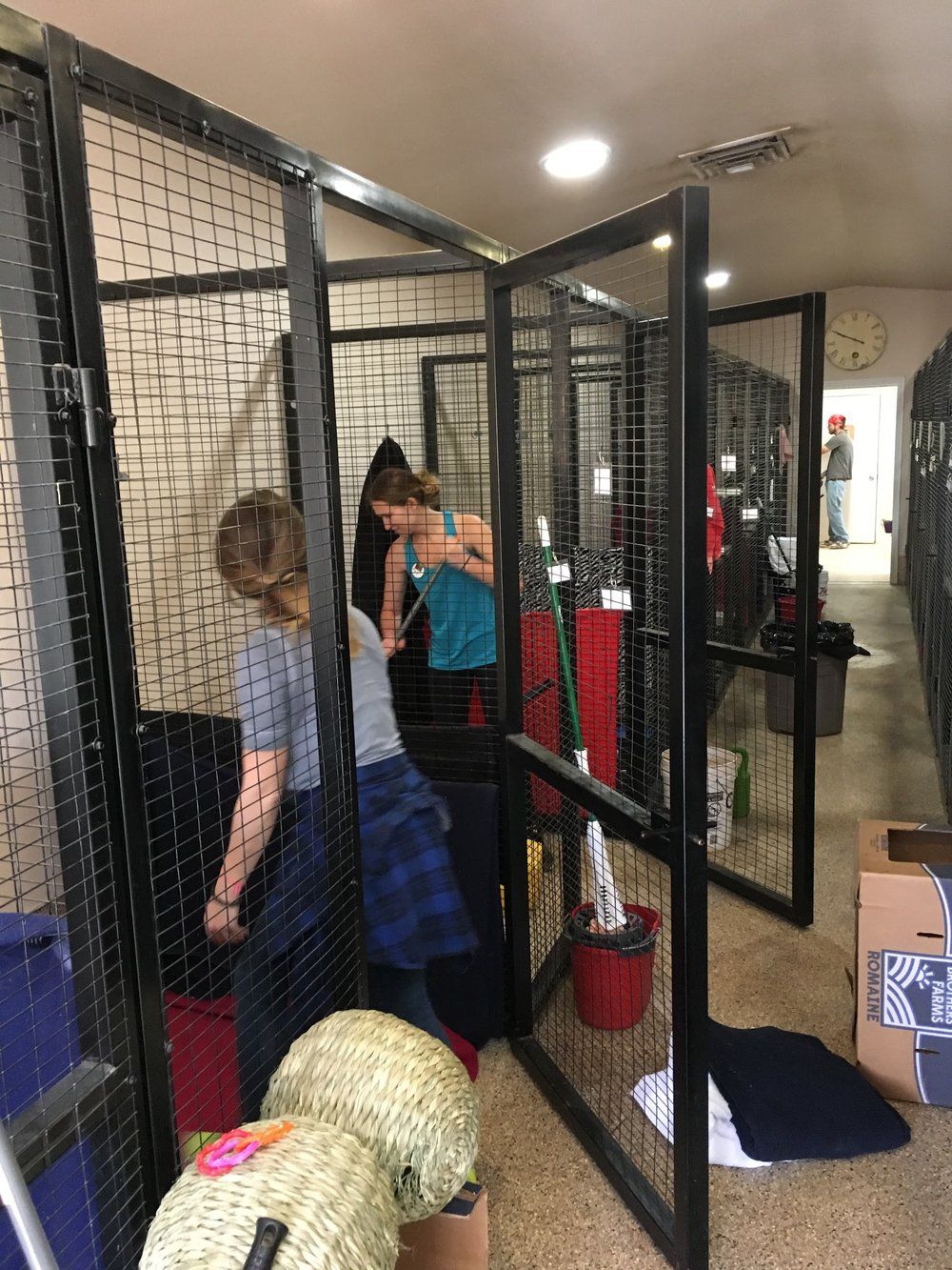 Laura and Hannah Cleaning Bunny Cages.JPG