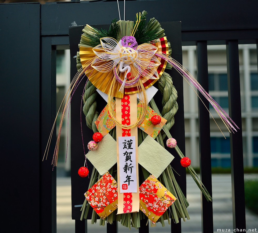 Shimenawa, the sacred braided straw rope used in a  shimekazari  decoration, holds deep meaning for the Japanese. When hung above the entryway of a site, it marks the border to pure space where the gods can descend, such as the entrance to a shrine precinct or a ritual site.
