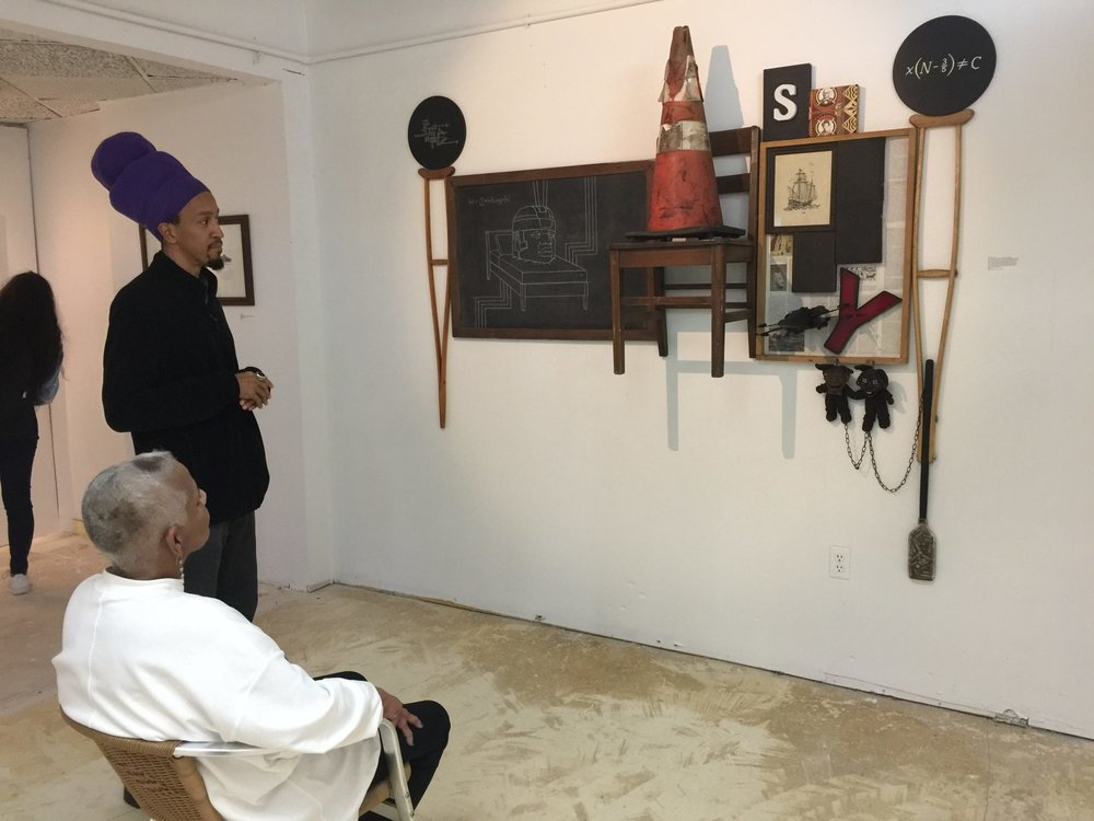 Peggy_Cooper_Cafritz_talking_with_artist_Andre_Leon_Gray.jpg