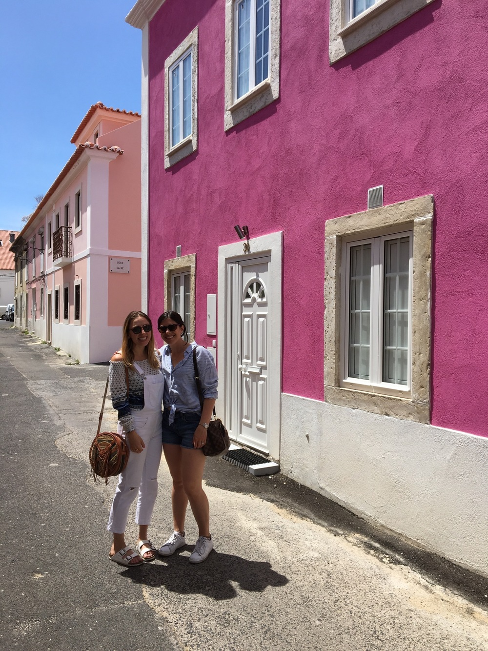Find this gorgeous pink house right across the street from the bridge by Torre de Belém.