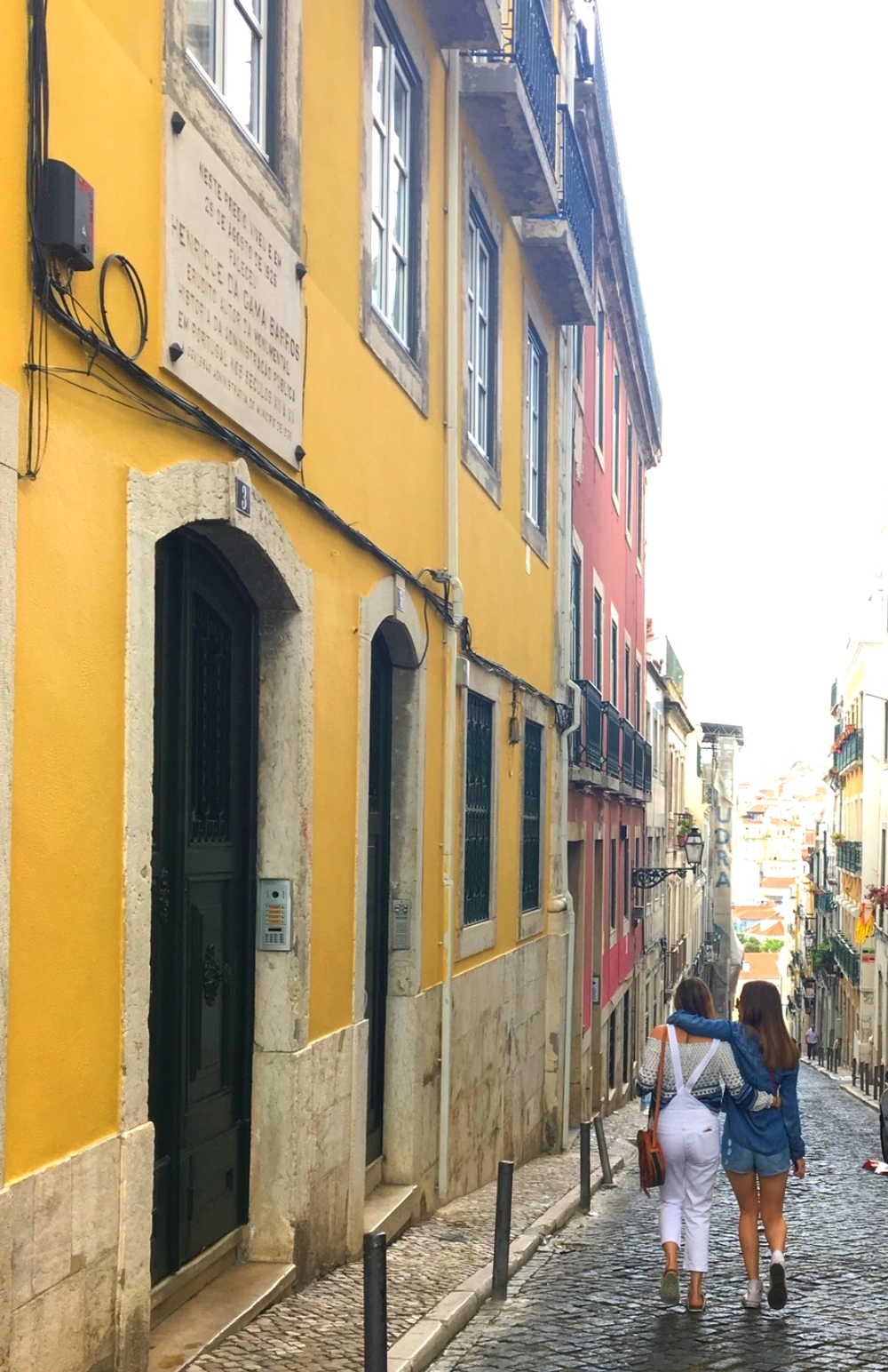 Amanda and her sister, Vikki, walking the streets of Lisbon.