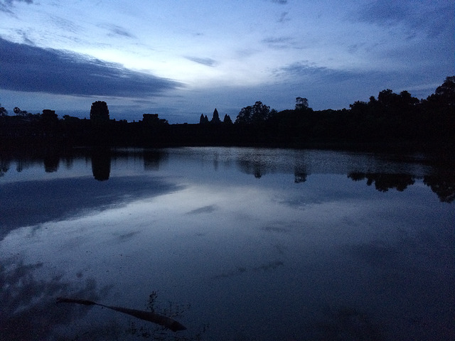 Angkor Wat at sunrise. This picture was taken outside the large moat that surrounds the temple city.