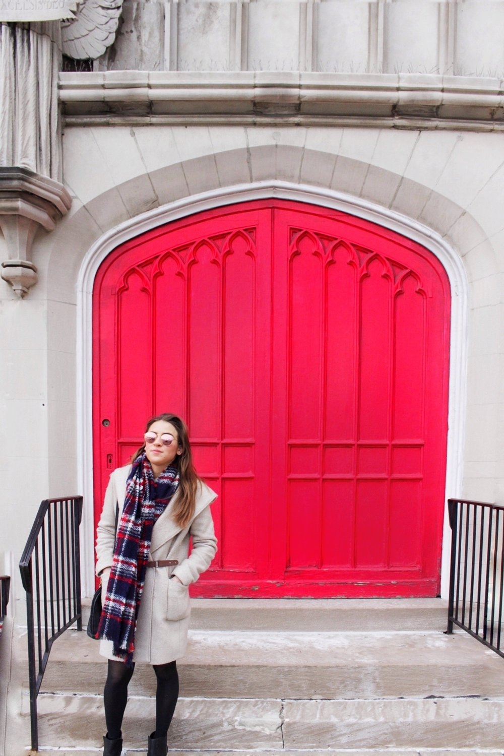 My sister, Vikki, posing in front of this vibrant red door of a church in Philadelphia. We walked by this on our way to Dilworth Park from her city apartment.
