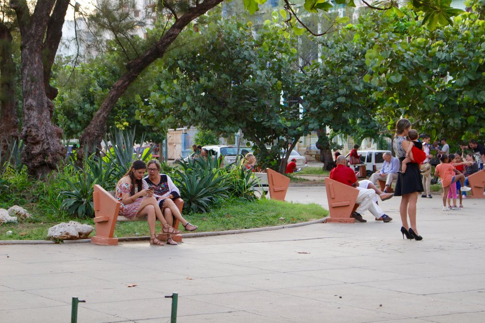 Locals in the wifi park. It costs about 3-4 CUCs per hour for internet access.