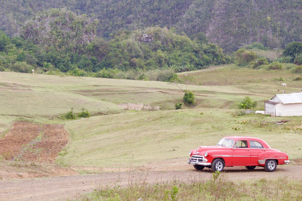 A vintage car parked in the valley.