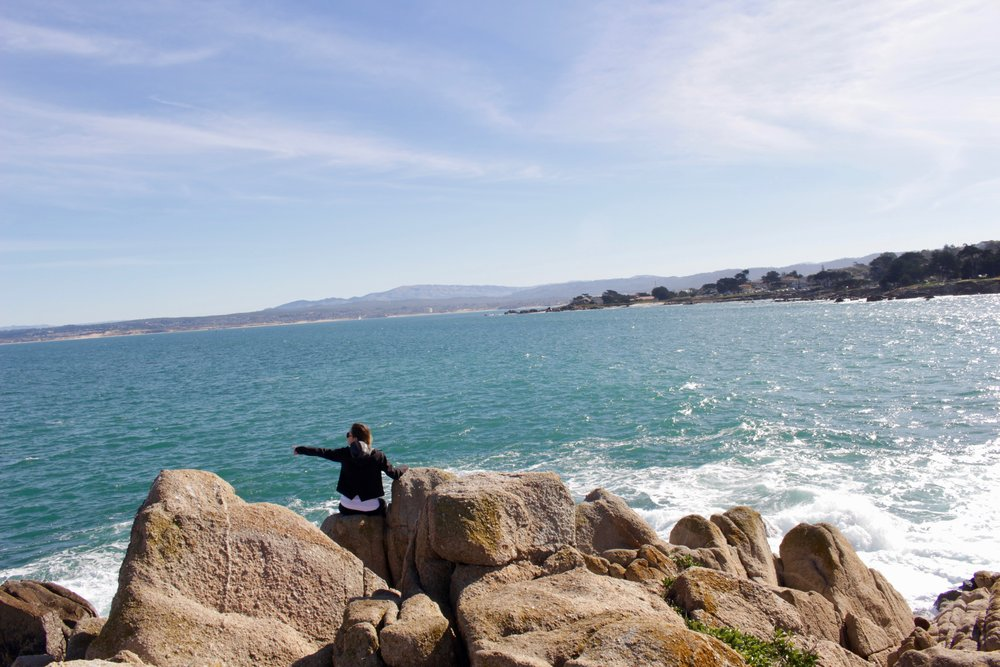 Climbing the rocks and spotting sea otters at Lovers Point Park.