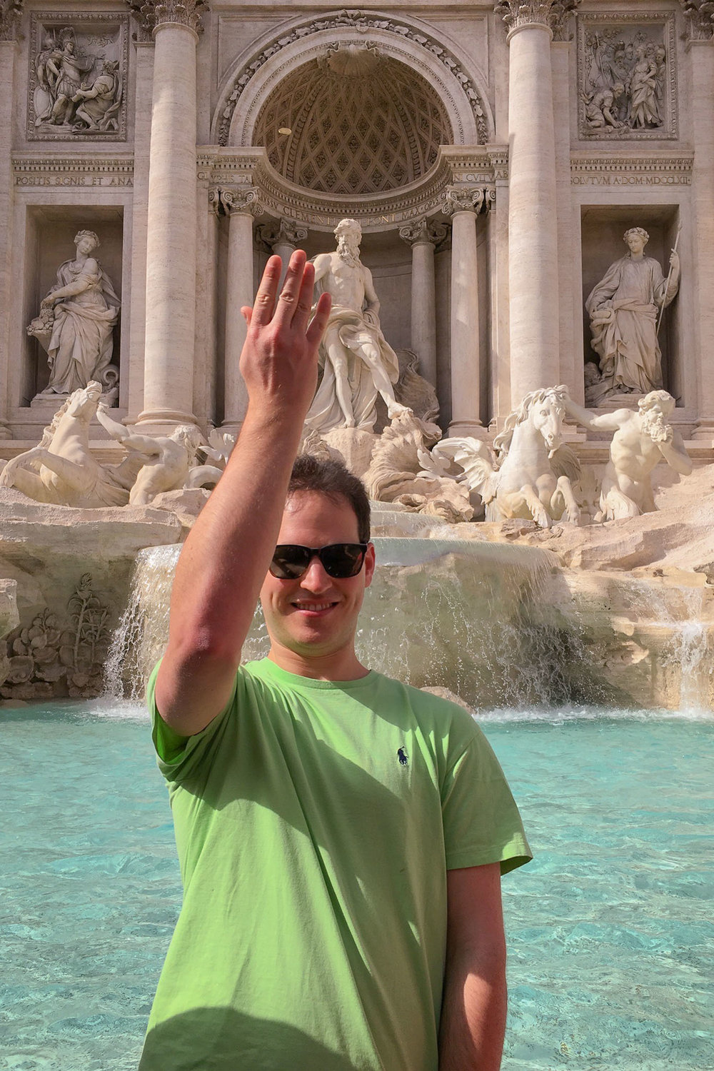 Dan tossing a coin in the Trevi Fountain. If you know, you know.