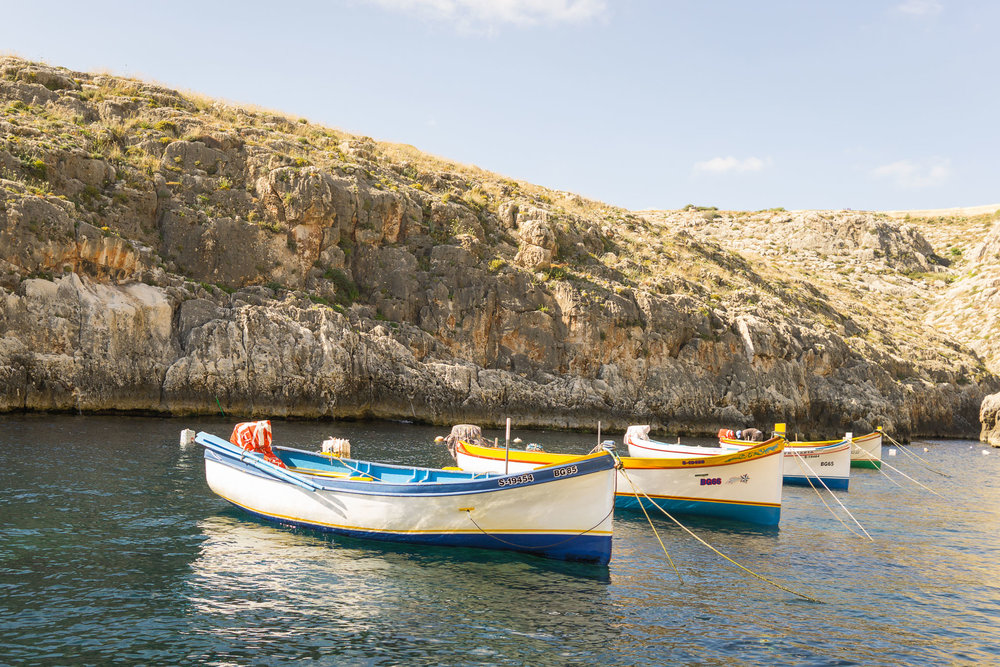 The boats for the ride to the Blue Grotto.