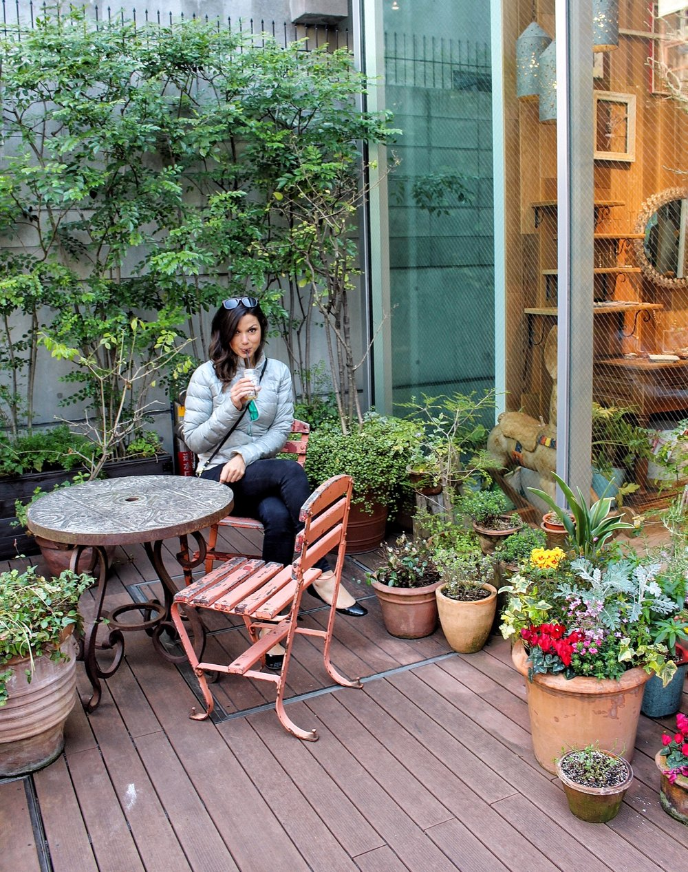 My friend,  Jessica , sipping her LiLo iced coffee outside a shop on Orange Street, Osaka.