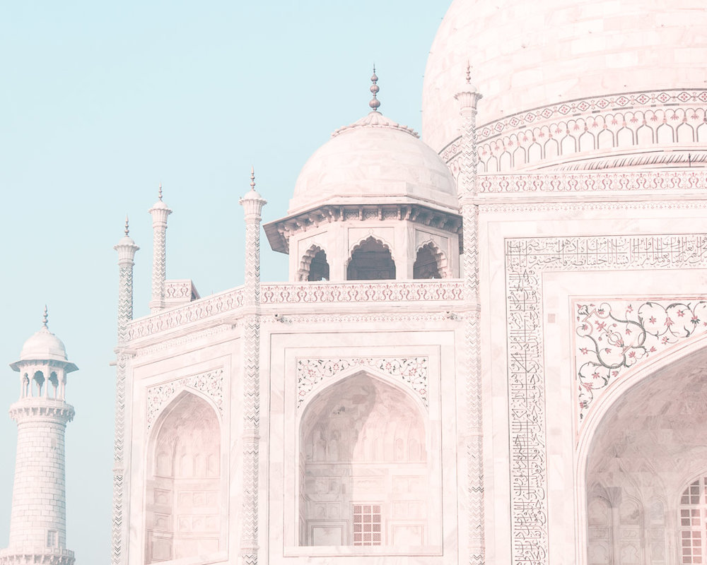 The jewels that cover the exterior of the Taj Mahal sparkle in the sunlight.