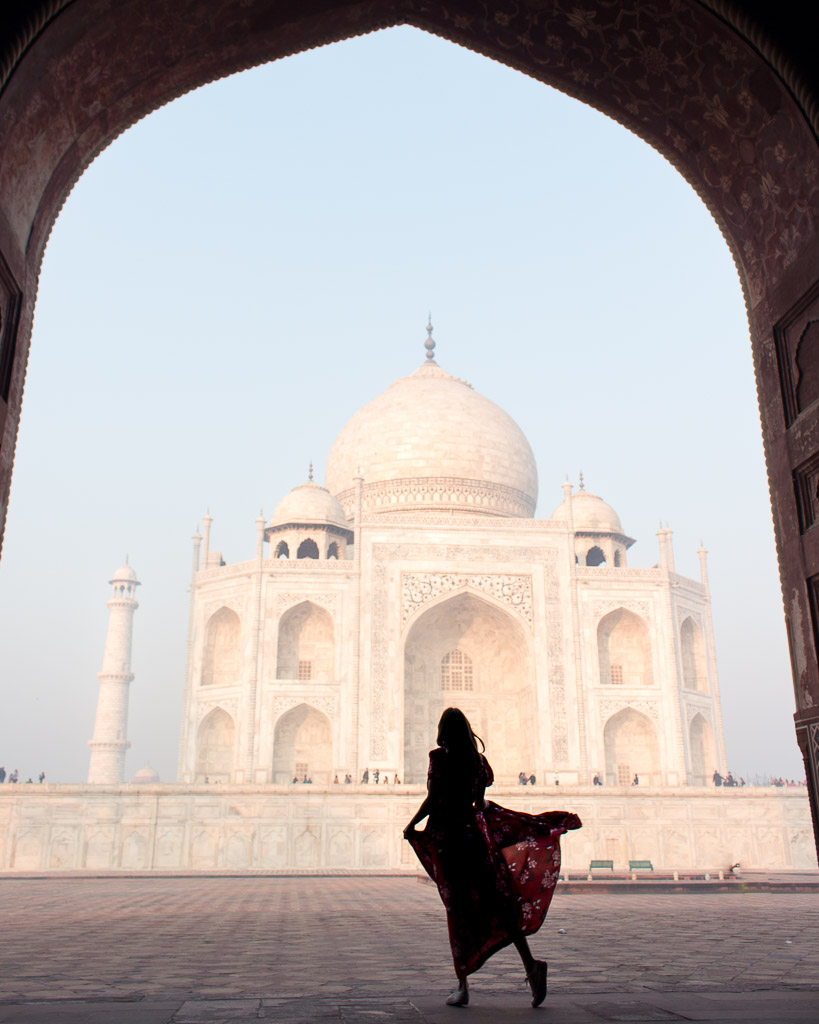 Watching the sunrise from under an arch of the red sandstone wall at the right side of the Taj Mahal. My boyfriend was laying on the ground to get this shot. He's a keeper.