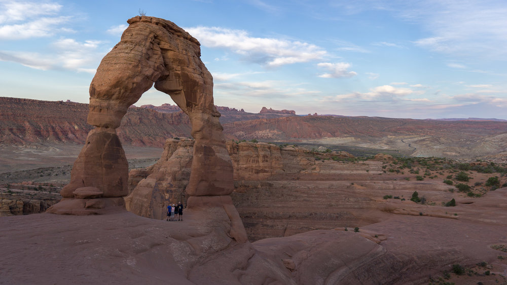 The crew for scale under Delicate Arch