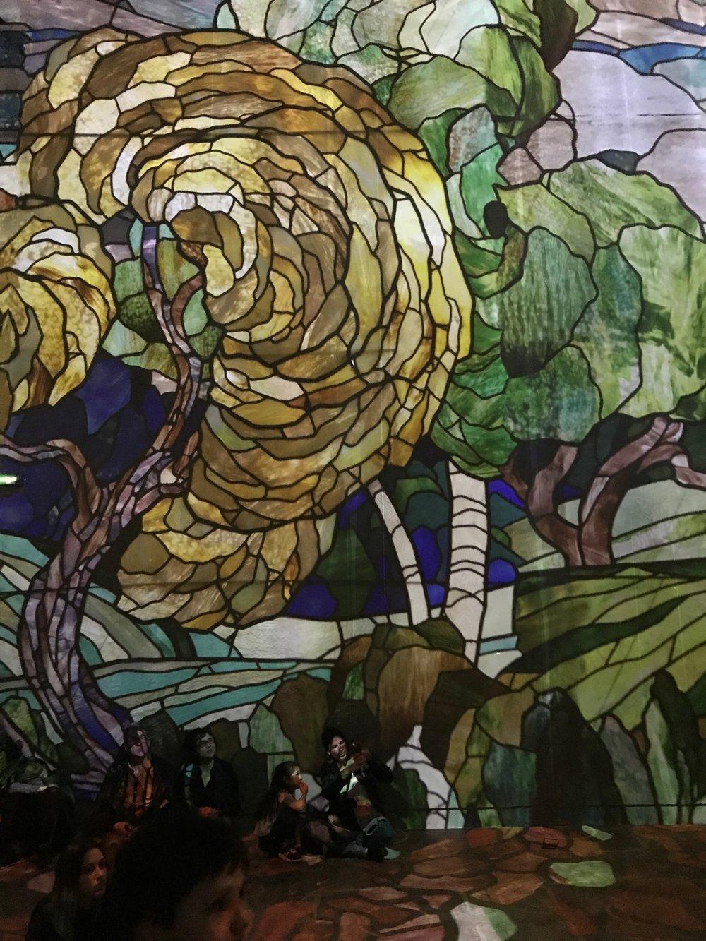 Digital artwork covering the walls of Atlier Luminaries.