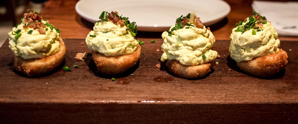 Lightly fried deviled eggs with bacon on top. I'm still dreaming about these. Find them at  Nick's Laguna Beach .