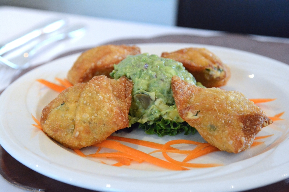 Cheese-filled wontons with a dollop of Helen's guacamole.