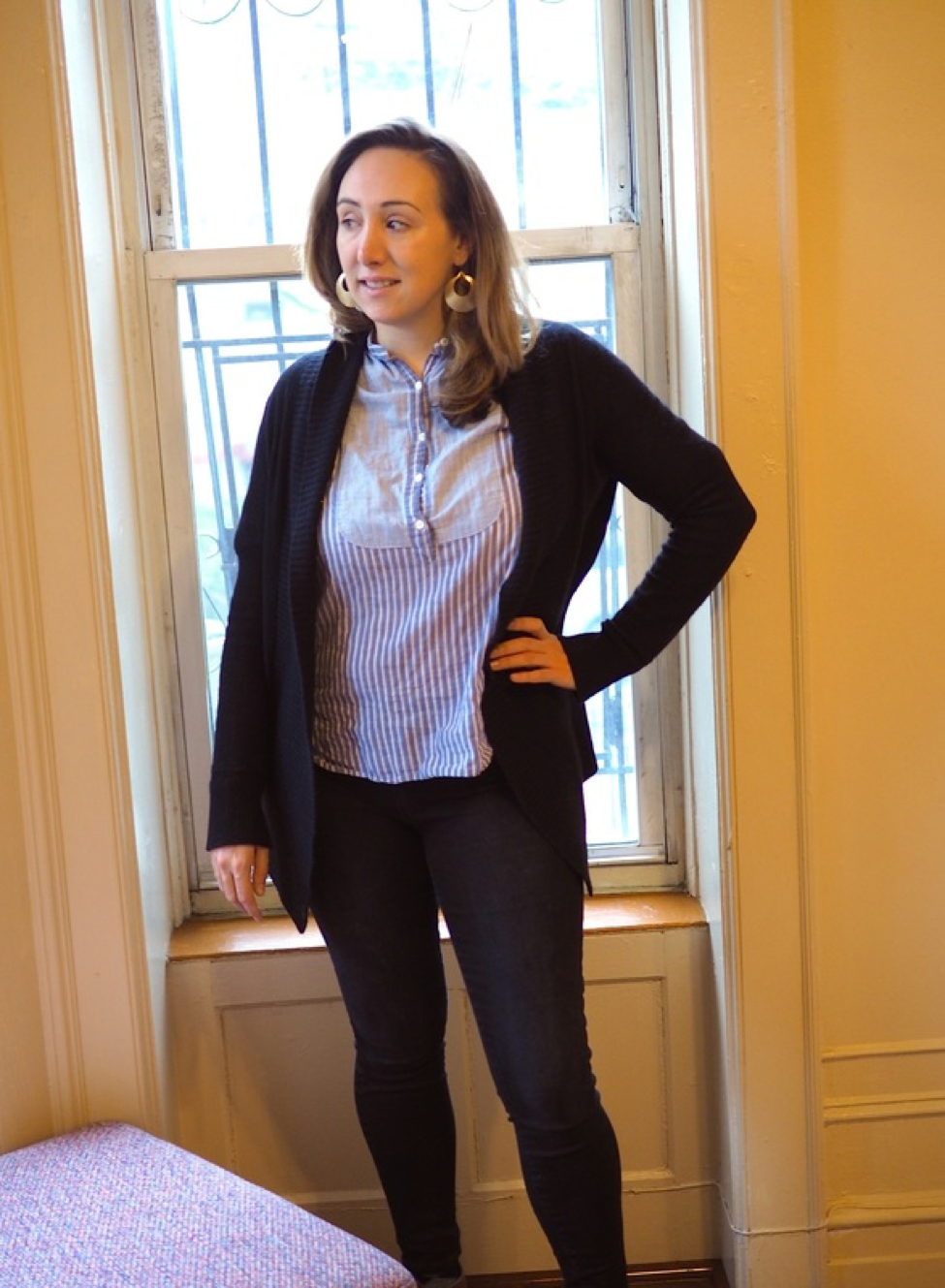 A possible pumping-friendly outfit with a shirt with front opening and a cardigan.