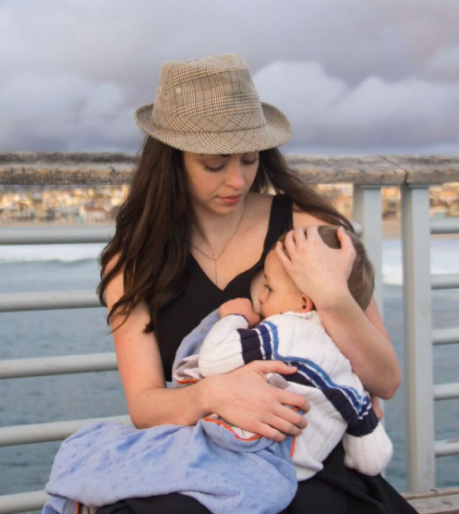 Photo: Katie Vigos feeding her son in our Katie Dress in Black