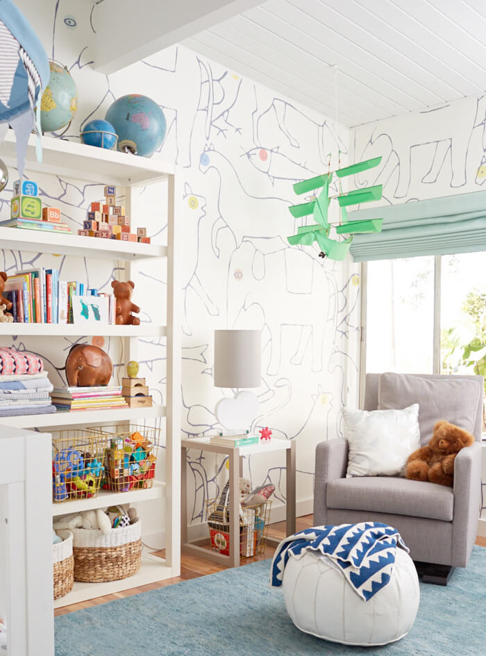 This stenciled-like walls are so creative and is our favorite part to this animal-themed nursery.      Style By Emily Henderson