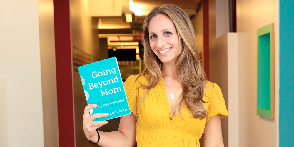 Randi Zinn of Beyond Mom with her book Going Beyond Mom