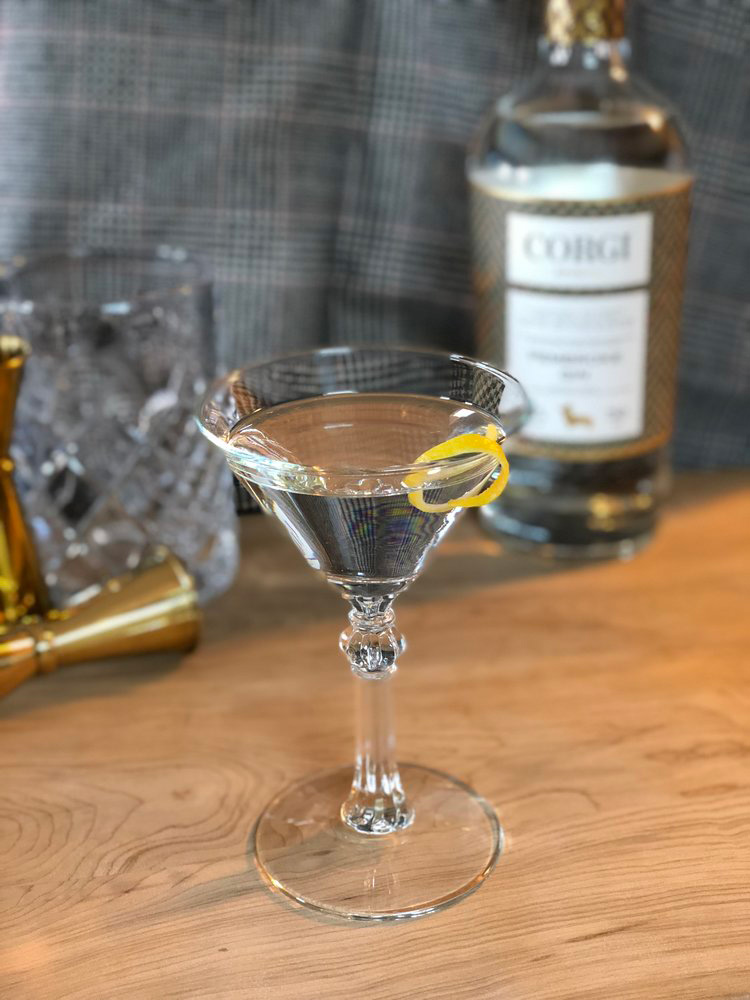 CLASSIC MARTINI   2.5oz Corgi Spirits Pembroke Gin  0.5oz dry vermouth  Lemon twist or olives for garnish     Fill a mixing glass with ice, add gin and vermouth. Stir until well chilled. Strain into a chilled cocktail glass. Add garnish.