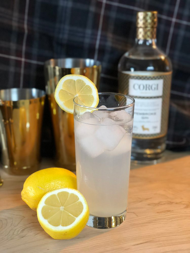TOM COLLINS   1.5oz Corgi Spirits Pembroke Gin  0.75oz fresh lemon juice  0.75oz simple syrup (1 part sugar : 1 part water)  Club soda  Lemon wheel for garnish     Fill a shaker with ice, add gin, lemon juice, and syrup, and shake vigorously. Strain into a Collins glass over fresh ice and top with club soda. Garnish with lemon wheel.
