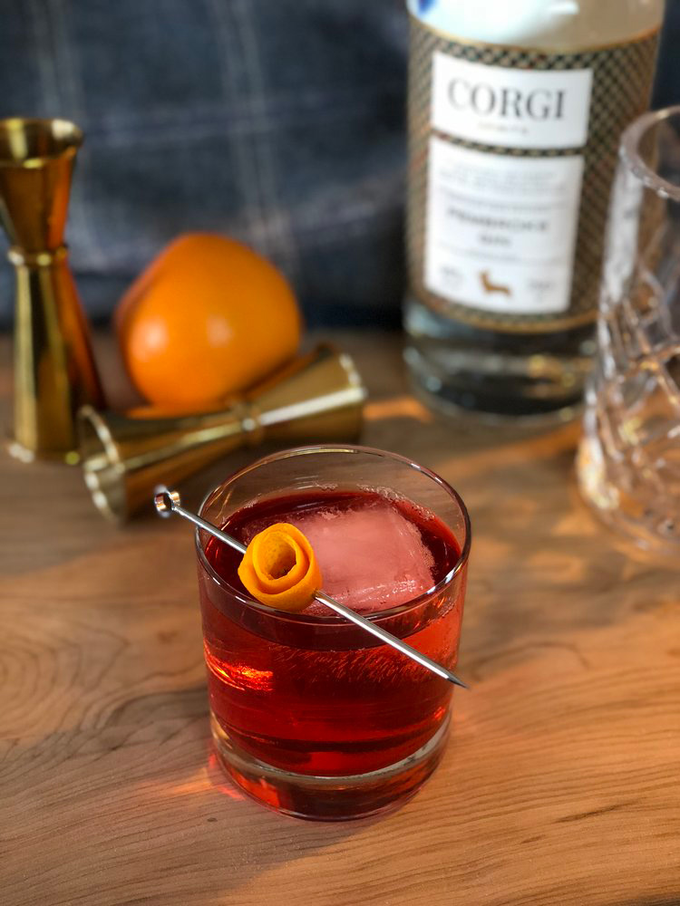 NEGRONI   1oz Corgi Spirits Pembroke Gin  1oz Campari  1oz sweet vermouth  Orange peel for garnish     Fill a mixing glass with ice, add all ingredients and stir thoroughly until well chilled. Strain over one large ice cube in a rocks glass. Garnish with an orange peel, expressing the oils over the top of the drink.