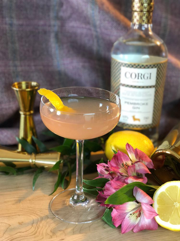 LAVENDER FIELDS FOREVER   1.5oz Corgi Spirits Pembroke Gin  0.5oz fresh lemon juice  0.5oz peach puree  0.5oz simple syrup (1:1)  0.25oz lavender tincture (see below)  1 dash black walnut bitters  Lavender sprig or lemon peel for garnish    Fill a shaker with ice, add all ingredients,and shake vigorously. Strain into a chilled cocktail glass and garnish with lavender sprig or lemon peel.  To make lavender tincture, combine 1/2 cup dried lavender flowers with 2 cups vodka in a mason jar. Shake well and allow to sit for up to one week, shaking occasionally. Strain and retain liquid.