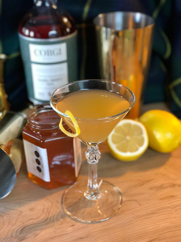 THE TEA'S KNEES   2oz Corgi Spirits Earl Grey Gin  0.75oz lemon juice  0.75oz honey syrup (2 honey : 1 water)  2 dashes Angostura bitters  Lemon peel for garnish     Fill a shaker with ice, add gin, lemon juice, honey syrup, bitters, and shake vigorously. Pour into a chilled cocktail glass. Add garnish.