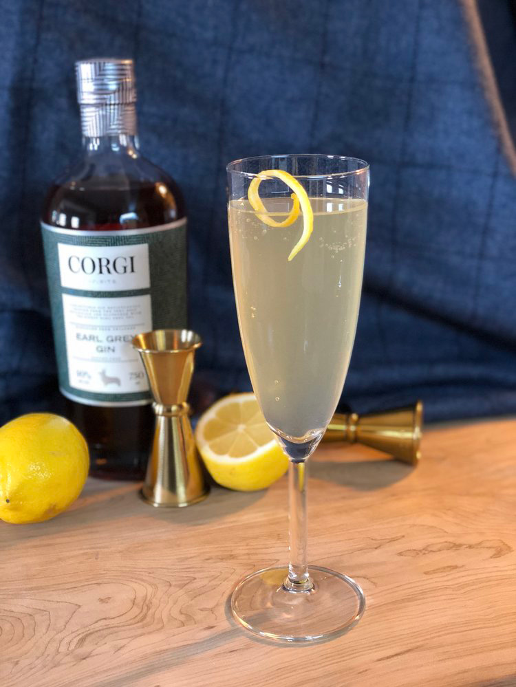 BRIT 75   1oz Corgi Spirits Earl Grey Gin  0.5oz fresh lemon juice  0.5oz simple syrup (1 part sugar : 1 part water)  Sparkling wine  Lemon twist for garnish    Fill a shaker with ice, add gin, lemon juice, and syrup, and shake vigorously. Strain into a chilled champagne glass and top with sparkling wine. Add lemon twist.