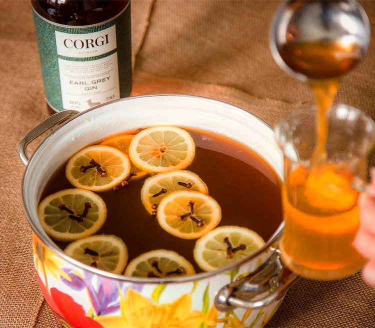 HOT EARL GREY PUNCH   32oz Corgi Spirits Earl Grey Gin  32oz fresh orange juice  16oz fresh lemon juice  16oz honey syrup (1 parts honey : 1 part water)  32oz water  Cinnamon sticks, cloves, and lemon slices for garnish     Combine all ingredients in a crock pot and simmer on low. Serve in a mug with a lemon slice, cinnamon stick, and cloves to garnish.