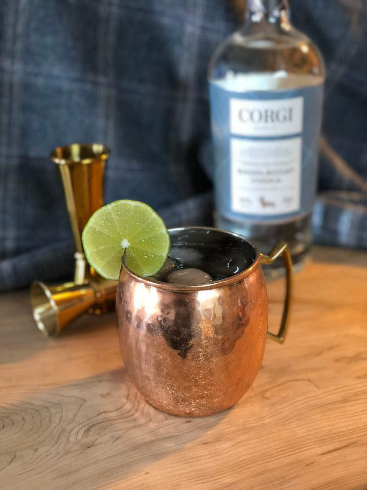 MOSCOW MULE   1.5oz Corgi Spirits Saddlecoat Vodka  0.25oz fresh lime juice  Ginger beer (Fever Tree preferred)  Lime wheel for garnish    In a cocktail shaker, add ice, gin, and lime juice, and shake vigorously. Strain into a copper mug over fresh ice, top with ginger beer, and garnish with a lime wheel.