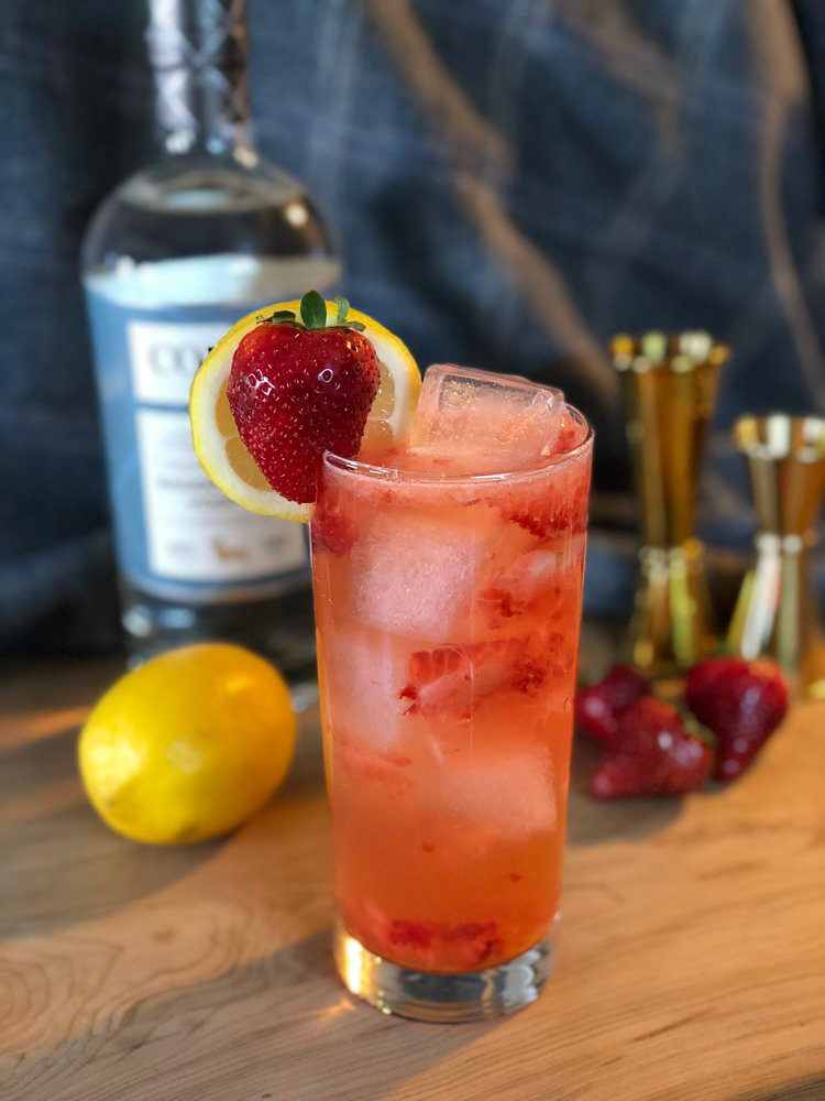 STRAWBERRY SMASH   2oz Corgi Spirits Saddlecoat Vodka  0.75oz fresh lemon juice  1oz simple syrup (1 part sugar : 1 part water)  2 strawberries, cut in half  Club soda  Lemon wheel and strawberry for garnish    In a shaker, muddle strawberries, add ice,vodka, lemon juice, and syrup, and shake vigorously. Strain into a Collins glass over fresh ice and top with club soda. Garnish with lemon wheel and strawberry.