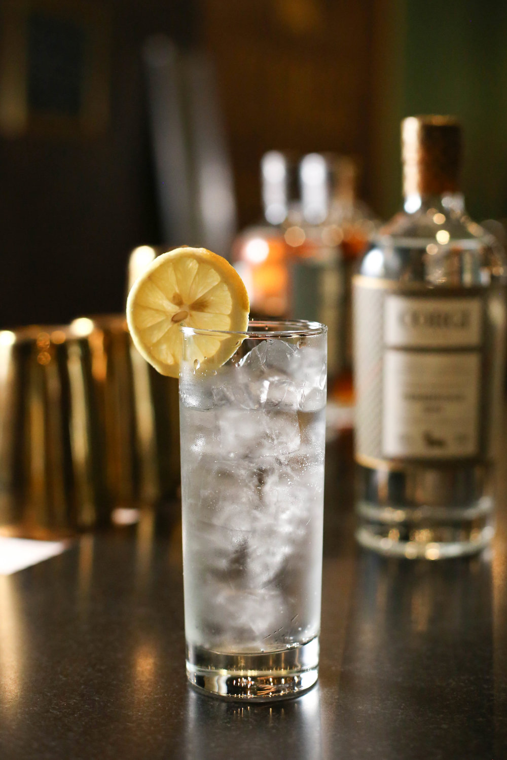 GIN & TONIC   2 oz Corgi Spirits Pembroke Gin  1 - 200mL bottle Fever Tree tonic water  Lemon for garnish    Fill a Collins glass with ice, add gin and stir to chill thoroughly. Pour tonic water into glass while gently stirring to combine. Add garnish.