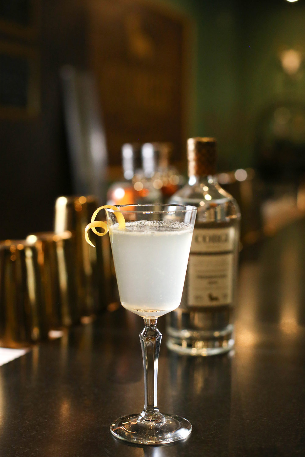 FRENCH 75   1oz Corgi Spirits Pembroke Gin  0.5 oz fresh lemon juice  0.5 oz simple syrup (1 part sugar : 1 part water)  Sparkling wine  Lemon twist for garnish    Fill a shaker with ice, add gin, lemon juice, syrup and shake vigorously. Strain into a chilled champagne glass and top with sparkling wine. Add lemon twist.