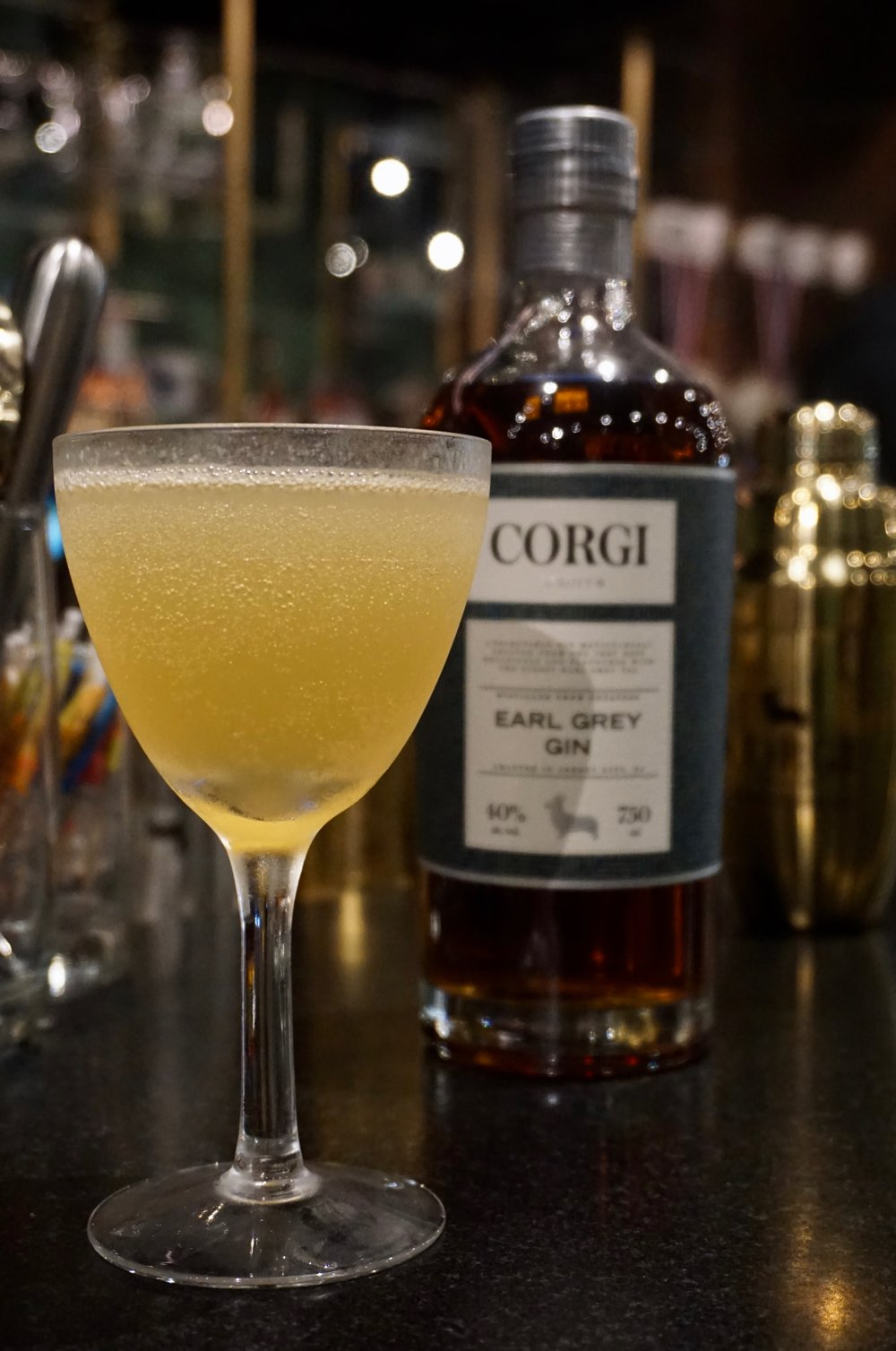 BRIT 75   1oz Corgi Spirits Earl Grey Gin  0.5oz fresh lemon juice  0.5oz simple syrup (1 part sugar : 1 part water)  Sparkling wine  Lemon twist for garnish    Fill a shaker with ice, add gin, lemon juice, syrup and shake vigorously. Strain into a chilled champagne glass and top with sparkling wine. Add lemon twist.