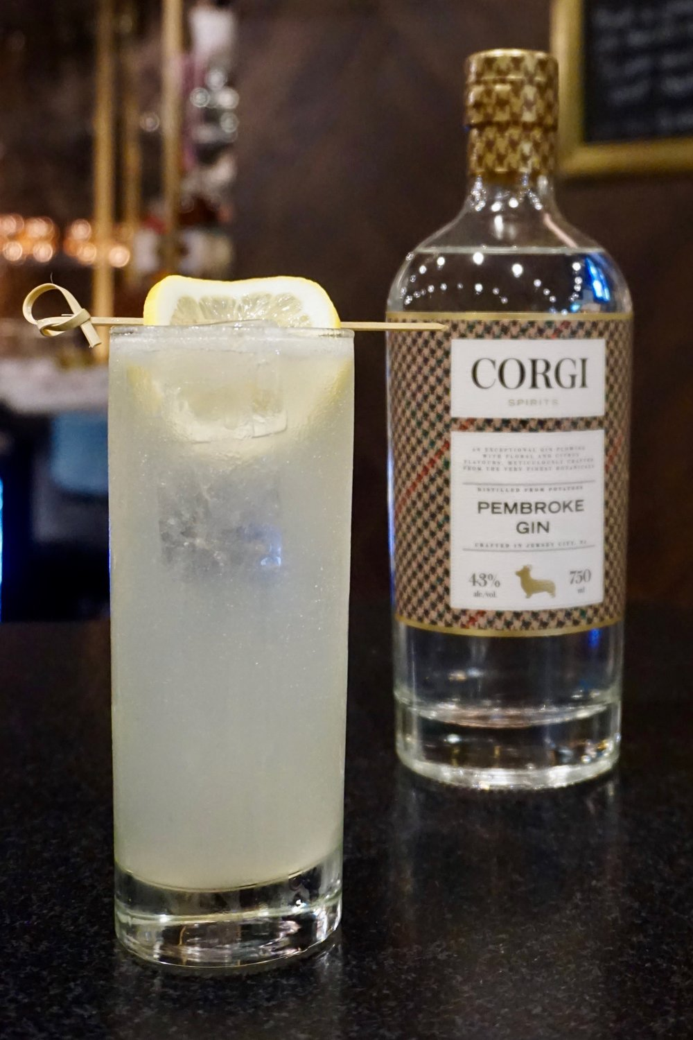 TOM COLLINS   1.5oz Corgi Spirits Pembroke Gin  0.75oz fresh lemon juice  0.75oz simple syrup (1 part sugar : 1 part water)  Club soda  Lemon wheel for garnish    Fill a shaker with ice, add gin, lemon juice, syrup and shake vigorously. Strain into a Collins glass over fresh ice and top with club soda. Garnish with lemon wheel.