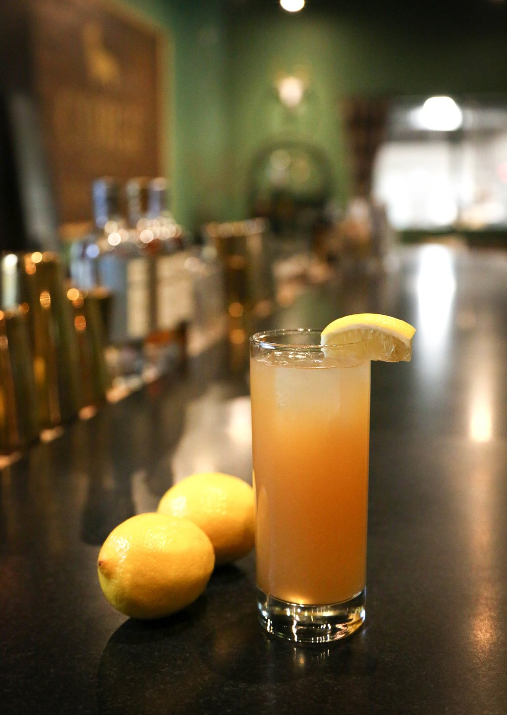 GREEN JACKET   2 oz Corgi Spirits Earl Grey Gin  1 oz fresh lemon juice  1 oz water  2 oz mango puree 2 OR 1 oz simple syrup  2 dashes Angostura Bitters    Fill a shaker with ice, add all ingredients and shake vigorously. Pour into a highball glass and garnish with lemon wheel.