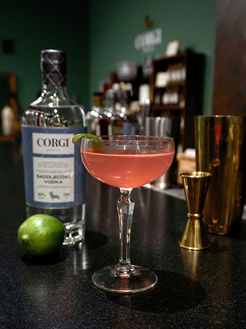 COSMO   2 oz Corgi Spirits Saddlecoat Vodka  3/4 oz Triple Sec  3/4 oz fresh lime juice  1 oz cranberry juice cocktail   Add all the ingredients into a shaker with ice and shake. Strain into a chilled cocktail glass. Garnish with a lime wedge.